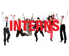 Image of 6 people jumping in the air throwing their hands with the word Interns in front of people.